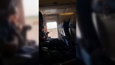 China Woman Opens Plane's Emergency Exit